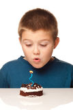 Boy making a wish Stock Photos