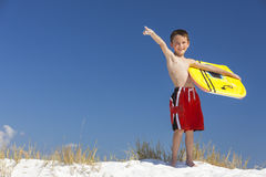 Boy Male Child Pointing on Beach With Surfboard Royalty Free Stock Images
