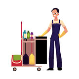 Boy, man, cleaner in overalls with cleaning trolley, vector illustration Stock Image