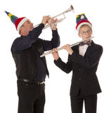 A boy and a man in elf hats Stock Photo