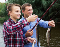 Boy and man fishing Royalty Free Stock Photos