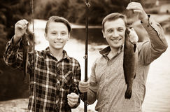 Boy and man fishing Royalty Free Stock Images