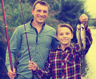 Boy and man fishing Royalty Free Stock Photography