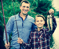 Boy and man fishing Stock Photos