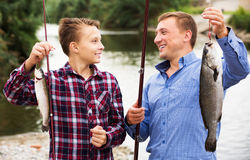 Boy and man fishing Royalty Free Stock Image