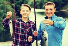 Boy and man fishing Stock Image