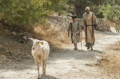 Boy and man with goat in nazareth israel stock photo