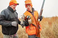 Teenage Boy and man pheasant hunting Stock Photos