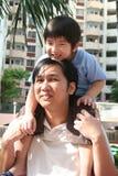 Boy on man's shoulder Royalty Free Stock Photo