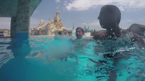 Boy and man underwater pool. man and a boy are floating swimming underwater. Family swims in the pool underwater. Boy and man underwater pool. man and a boy are stock video