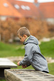 Boy with mancala game Stock Photos