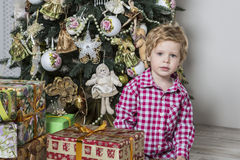 Boy with many Christmas gifts Royalty Free Stock Photos