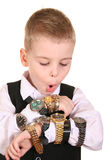 Boy with many clocks. On white Stock Image