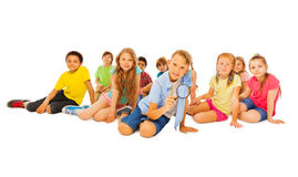 Boy and many friends with magnifier glass Royalty Free Stock Photography
