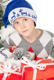 Boy with many Xmas gifts. High angle view closeup of astonished little boy sitting on the floor with heap of Xmas presents Royalty Free Stock Photo