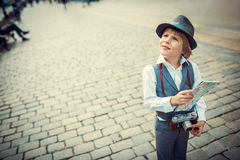 Boy with map Royalty Free Stock Photography