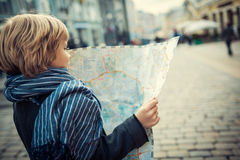 Boy with map Royalty Free Stock Photos