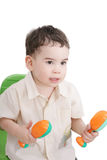 Boy with maracas Royalty Free Stock Images