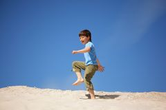 Boy marching on beach Royalty Free Stock Image