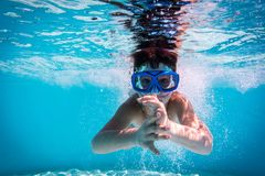 Boy in mask dive in swimming pool Royalty Free Stock Photo