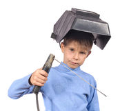 Boy in a mask with electric welding Stock Image