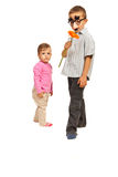 Boy with mask  and little girl Stock Images