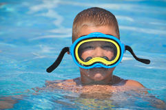 Boy with a mask in the pool Royalty Free Stock Image