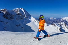 Boy in mask skiing with beautiful mountain view Royalty Free Stock Image