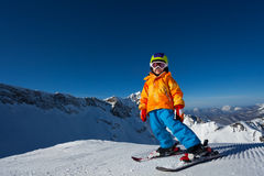 Boy in mask skiing on Krasnaya polyana ski resort Stock Photos