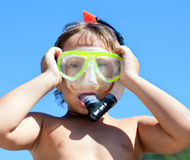 Boy in mask with a tube for diving Stock Images