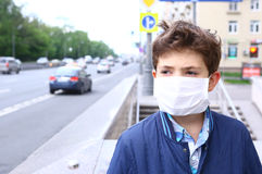 Boy in mask on the urban background Stock Images