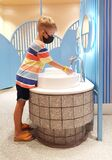Boy in the mask washing hands with soap. Qarantine