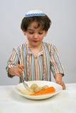 Boy matzo ball soup. Jewish young boy having matzo ball soup Stock Photo