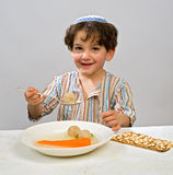 Boy matzo ball soup. Jewish young boy having matzo ball soup Stock Photos
