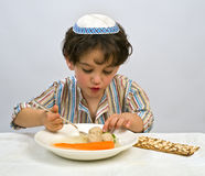 Boy matzo ball soup. Jewish young boy having matzo ball soup Stock Image