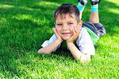 Boy on meadow Stock Image
