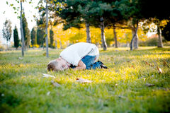 Boy on meadow. Boy lying and smiling on meadow in autumn royalty free stock photography