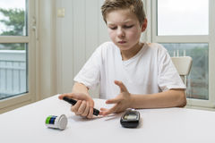 Boy measure glucose or blood suger royalty free stock photos