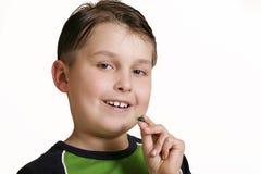 Boy with medicine capsule Stock Photos