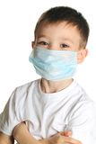 Boy in medicine mask Royalty Free Stock Image