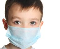 Boy in medicine mask Royalty Free Stock Images