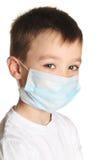 Boy in medicine mask Stock Image
