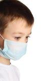 Boy in medicine mask Stock Photos