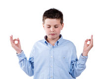 Boy meditating Royalty Free Stock Photo