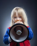 Boy with megaphone Royalty Free Stock Images