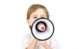 Boy with a megaphone. A young boy with a megaphone isolated on white Royalty Free Stock Photography