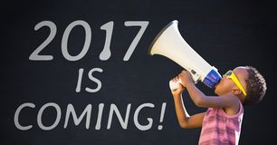 Boy with megaphone against 2017 new year sign Royalty Free Stock Images