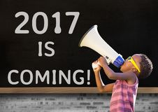 Boy with megaphone against 2017 new year sign Stock Images