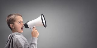 Boy with megaphone making an announcement. With copy space Stock Images