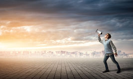 Boy with megaphone Stock Images